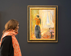 Visitor looking at painting, Woman Looking in the Mirror by Edvard Munch,  at new Museum Barberini in Potsdam Germany