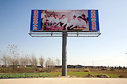 A billboard in the town of Xiaogang, celebrates the communist party history of the town.