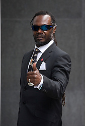 © Licensed to London News Pictures. 16/11/2011. London, UK. Levi Roots arriving at The Royal Courts Of Justice today (16/11/2011) where Roots is being sued by his former friend, chef Tony Bailey, for more than £300,000 over claims the musician ran off with his coveted recipe, breaking an agreement to share the profits. Photo credit: Ben Cawthra/LNP