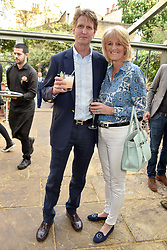 David & Lady Isabella Naylor-Leyland at The Ivy Chelsea Garden's Annual Summer Garden Party, The Ivy Chelsea Garden, 197 King's Road, London England. 9 May 2017.<br /> Photo by Dominic O'Neill/SilverHub 0203 174 1069 sales@silverhubmedia.com