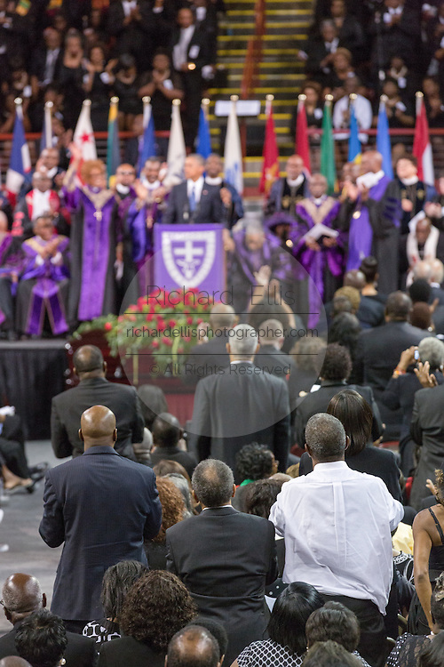 U.S. President Barack Obama is given a standing ovation a he delivers the eulogy at the funeral of slain State Senator Clementa Pinckney at the TD Arena June 24, 2015 in Charleston, South Carolina. Pinckney is one of the nine people killed in last weeks Charleston church massacre.