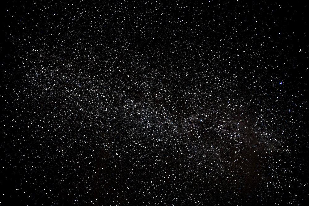 Stars in the night sky above Bunes Beach, Moskenesoya, Lofoten Islands, Norway.