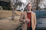 """BIRMINGHAM, AL – JANUARY 27, 2016: John George, 63, stands near his 2014 Ford Taurus. When purchasing the vehicle in 2013, George became frustrated when the dealership informed him he was ineligible for special financing due to poor credit. George, who is financially stable, has purchased multiple vehicles with cash in his lifetime and decided early on to """"not play the credit game. It's just the way I was raised,"""" George said. """"You only borrowed money for an asset that appreciates in value. If you had the money you bought it, and if you didn't have the money, you didn't. It was that simple.""""<br /> CREDIT: Bob Miller for The New York Times"""