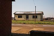 "Arcelor Mittal. Omarska Mine near Prijedor.<br /> <br /> The ""White House"" at Omarska.<br /> <br /> Matt Lutton / Boreal Collective for the Financial Times."