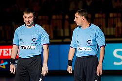 Referees Evgenij Zotin and Nikolaj Volodkov of Russia during handball match between RK Celje Pivovarna Lasko and IK Savehof (SWE) in 3rd Round of Group B of EHF Champions League 2012/13 on October 13, 2012 in Arena Zlatorog, Celje, Slovenia. (Photo By Vid Ponikvar / Sportida)