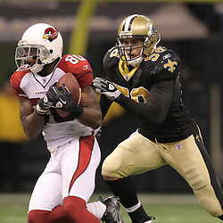 16 January 2010:  Arizona Cardinals wide receiver Early Doucet (80) is pursued by New Orleans Saints linebacker Scott Shanle (58) during a 45-14 win by the New Orleans Saints over the Arizona Cardinals in a 2010 NFC Divisional Playoff game at the Louisiana Superdome in New Orleans, Louisiana.