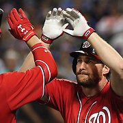 NEW YORK, NEW YORK - July 09: Daniel Murphy #20 of the Washington Nationals celebrates his two run home run in the seventh inning with Bryce Harper #34 of the Washington Nationals during the Washington Nationals Vs New York Mets regular season MLB game at Citi Field on July 09, 2016 in New York City. (Photo by Tim Clayton/Corbis via Getty Images)
