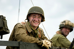 """Re-enactors portraying the American 101st Airborne """"Screaming Eagles"""" advancing during a large scale battle re-enactment. SPAM 1940's Weekend. Heckmondwyke near Wakefield 10 July 2010 <br /> Images © Paul David Drabble"""