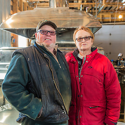 Lili and Mario Giroux in front of the sap boiler in their sugarhouse in Big Six Township, Maine.