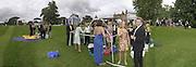 Assembing picnic tent. Louis Vuitton Concours d'Elegance, Hurlingham.  8 June 2002.  Copyright Photograph by Dafydd Jones 66 Stockwell Park Rd. London SW9 0DA Tel 020 7733 0108 www.dafjones.com