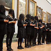 """Liberate Tate perfoms an art intervention as a political statement against BP's continued sponsorship of the Tate galleries. Parts of their press release reads:  """"Fifty veiled figures dressed in black today carried out a performance art installation entitled 'Parts Per Million' throughout a series of rooms in the 'BP Walk Through British Art' at Tate Britain during the art gallery's official re-opening (Saturday 23 November 2013). The piece critiqued the role that Tate is playing in exacerbating climate change by bolstering the public perception of BP through its long-standing sponsorship relationship."""""""