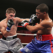 "Luis Olivares (silver) fights against Jeffery Ramos during the ""Boxeo Telemundo"" boxing match at the Kissimmee Civic Center on Friday, March 14, 2014 in Kissimmme, Florida. (Photo/Alex Menendez)"