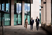 Business people and bankers walking past corporate offices in the offshore finance centre of St Helier, Jersey, CI