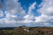 Dramatic blue sky filled with white clouds above Carreg Cennen Castle which sits at the top of a limestone cliff, Trapp, Brecon Beacons, Powys, UK. The castle has been in a ruinous state since 1462 and is under the care of Cadw, the Welsh Government historic environment service, however the estate is used as working farm land. (photo by Andrew Aitchison / In pictures via Getty Images)