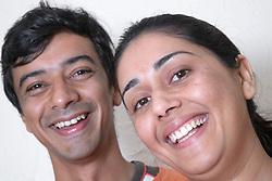 Portrait of a couple smiling,