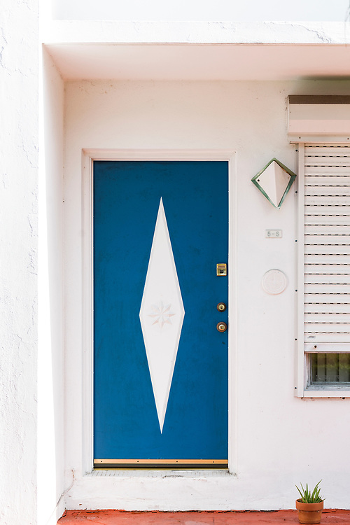 Bay Harbor Islands: a Miami Modern door with star and diamond motifs