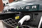 Range Rover SUV car at an electric charging point in London, England, United Kingdom. An electric car is an automobile that is propelled by one or more electric motors, using electrical energy stored in rechargeable batteries or another energy storage device. The resulting drop in harmful emissions makes eco cars an ecologically sound alternative to regular fuel cars.