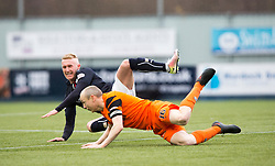 Falkirk's Craig Sibbald tackled by Dundee United's Willo Flood. half time : Falkirk 1 v 0 Dundee United, Scottish Championship game played 11/2/2017 at The Falkirk Stadium.