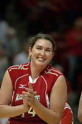 09 OCT 2005 Redbird Laura Doornbos takes a moment to enjoy a big smile while singing the fight song after the end of the match. The Illinois State University Redbirds hosted arch rival Bradley University Braves.  The Redbirds soared over the Braves, taking the match in 4 games, losing only game number 2.  Action included play by Braves Star Lindsey Stalzer who is ranked no. 7 in the nation in kills per game.  The first defeat of the conference season for the Braves took place at Redbird Arena on Illinois State's campus in Normal IL.