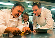 © Licensed to London News Pictures. 03/11/2014. Oxford, UK. NICK CLEGG (R) watches RAYMOND BLANC (L)  cook a ravioli dish with local school girl Miriam Willis aged 9.  To celebrate National School Meals Week (3-7 November), the Deputy Prime Minister, Nick Clegg, joins school children at Brasserie Blanc in Oxford to get some top cooking tips from Raymond Blanc. The visit is part of a larger national effort to raise awareness of and enhance children's relationship with food. The Deputy Prime Minister has called on celebrity chefs to lead the way by joining forces with school cooks to promote the great school lunch. School cooks up and down the country will be taking their skills out of the school kitchen to showcase to parents and pupils the variety and quality of food now being served in schools. National School Meals Week comes just months after the launch of free school meals for 2.8 million primary school children and the introduction of cooking in the curriculum.. Photo credit : Stephen Simpson/LNP