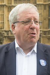 """Westminster, London, June 23rd 2016. Transport Secretary Patrick McLoughlin sporting an """"I'M IN"""" sticker is spotted outside Parliament."""