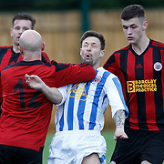 Renfrew v Maryhill Junior Football.  Maryhill's Paul McLernon gets a yellow card for this strong challenge on Renfrew's Ross Hocknall. Picture Robert Perry for The Herald and  Evening Times 12th Sept 2015<br /> <br /> Must credit photo to Robert Perry<br /> FEE PAYABLE FOR REPRO USE<br /> FEE PAYABLE FOR ALL INTERNET USE<br /> www.robertperry.co.uk<br /> NB -This image is not to be distributed without the prior consent of the copyright holder.<br /> in using this image you agree to abide by terms and conditions as stated in this caption.<br /> All monies payable to Robert Perry<br /> <br /> (PLEASE DO NOT REMOVE THIS CAPTION)<br /> This image is intended for Editorial use (e.g. news). Any commercial or promotional use requires additional clearance. <br /> Copyright 2014 All rights protected.<br /> first use only<br /> contact details<br /> Robert Perry     <br /> 07702 631 477<br /> robertperryphotos@gmail.com<br /> no internet usage without prior consent.         <br /> Robert Perry reserves the right to pursue unauthorised use of this image . If you violate my intellectual property you may be liable for  damages, loss of income, and profits you derive from the use of this image.