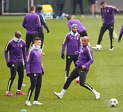 Manchester City's Samir Nasri and Vincent Kompany during the training session at the Etihad Campus ahead of the UEFA Champions League second leg match against FC Barcelona - Photo mandatory by-line: Matt McNulty/JMP - Mobile: 07966 386802 - 17/03/2015 - SPORT - Football - Manchester - Etihad Campus - Barcelona v Manchester City - UEFA Champions League