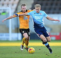 Blackpool's Brad Potts shields the ball from Cambridge United's Max Clark<br /> <br /> Photographer Chris Vaughan/CameraSport<br /> <br /> The EFL Sky Bet League Two - Cambridge United v Blackpool - Saturday 14th January 2017 - The Cambs Glass Stadium - Cambridge<br /> <br /> World Copyright © 2017 CameraSport. All rights reserved. 43 Linden Ave. Countesthorpe. Leicester. England. LE8 5PG - Tel: +44 (0) 116 277 4147 - admin@camerasport.com - www.camerasport.com