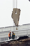 Moscow, Russia, 23/02/2006..Emergency workers on top of the remains of Baumanskii Marrket in eastern Moscow after the market roof collapsed, apparently under the weight of snow, killing many people.