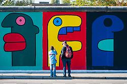 View of murals on Berlin Wall at East Side Gallery in berlin, Germany