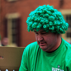 York, PA - March 12, 2016: A man wears a green wig in Irish spirit at the annual Saint Patrick's Day Parade in the City of York, Pennsylvania.