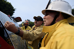 May 28, 2017 - Los Angeles, California, United States - Firefighters battle a wildfire in Mandeville Canyon in Los Angeles, California on May 28, 2017. More than 150 firefighters battle the fire that burns near multi-million dollar homes in the Brentwood neighborhood. (Credit Image: © Ronen Tivony/NurPhoto via ZUMA Press)