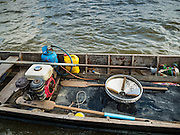 14 OCTOBER 2015 - BANGKOK, THAILAND: The air compressor and sluicing pan used by divers in the Chao Phraya River in Bangkok. Divers work in two man teams on small boats in the Chao Phraya River. One person stays in the boat while the diver scours the river bottom for anything that can be salvaged and resold. The divers usually work close to shore because the center of the river is a busy commercial waterway with passenger boats and commercial freight barges passing up and down the river all day long. The Chao Phraya is a dangerous river to dive in. It's deep, has large tidal fluctuations, is fast flowing and badly polluted. The divers make money only when they sell something.    PHOTO BY JACK KURTZ