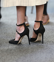 The shoes of Meghan Markle during a reception for the Commonwealth Youth Forum at the Queen Elizabeth II Conference Centre, London, during the Commonwealth Heads of Government Meeting.