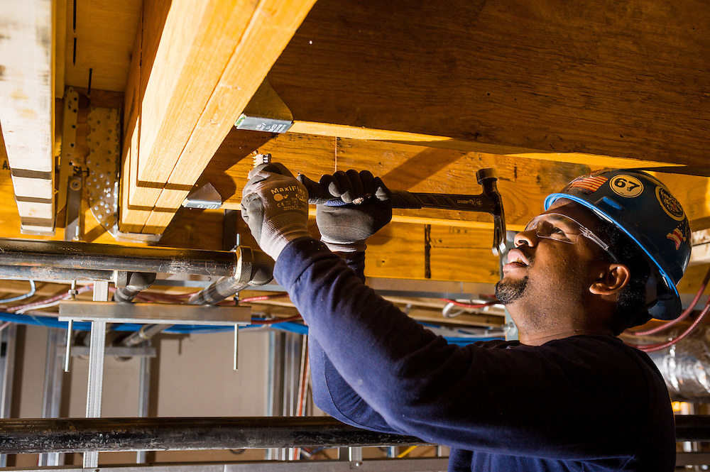 A construction worker at work in the Bromley Heath Learning Center in Jamaica Plain, MA.  Photographed for CWC Construction.