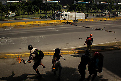 Opposition protesters throw Molotov bombs at the Venezuelan National Guard in a demonstration against the government of Nicolas Maduro this May 18, 2017.