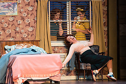 """© Licensed to London News Pictures. 14/05/2014. London, England. L-R: Kate Valentine as Fiordiligi, Christine Rice as Dorabella and Mary Bevan as Despina. Dress rehearsal of the Wolfgang Amadeus Mozart opera """"Così fan tutte"""" at the London Coliseum. A new ENO production of Mozart's dark comedy set in the world of a 1950's Coney Island funfair. With Kate Valentine as Fiordiligi, Christine Rice as Dorabella, Marcus Farnsworth as Guglielmo, Randall Bills as Ferrando, Mary Bevan as Despina and Roderick Williams as Don Alfonso. Directed by Phelim McDermott, Conductor: Ryan Wigglesworth. Co-produced by the English National Opera and the Metropolitan Opera, New York. In collaboration with Improbable. 12 performances from 16 May to 6 July 2014. Photo credit: Bettina Strenske/LNP"""