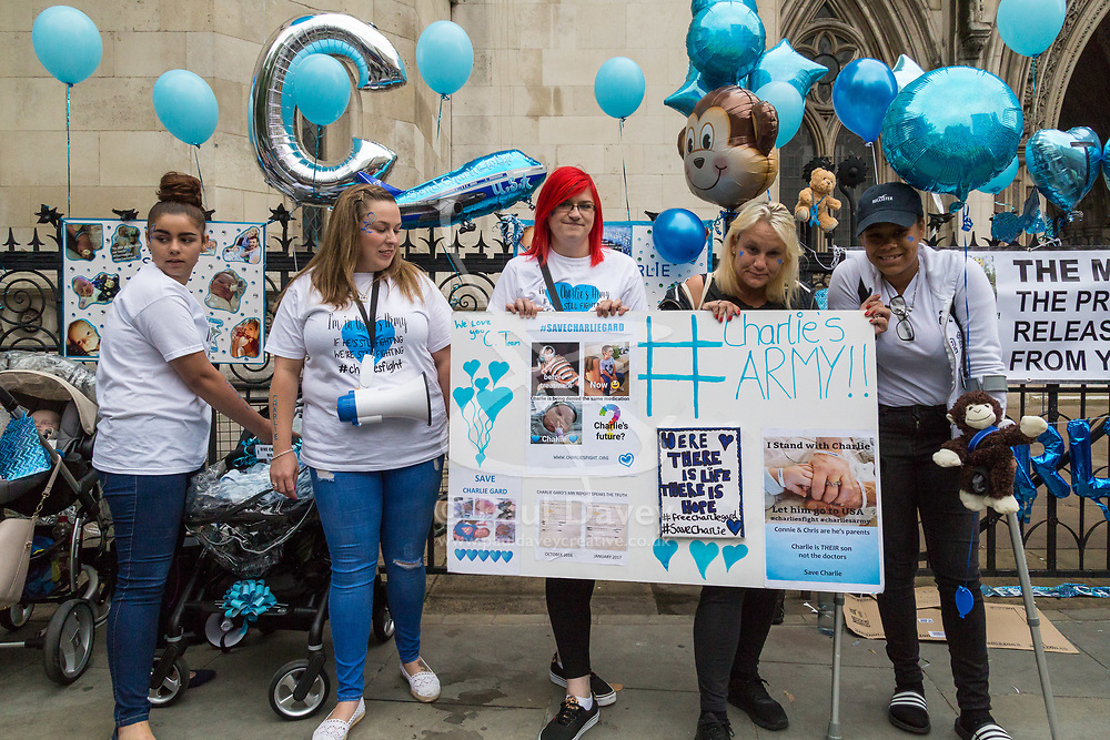 London, July 24th 2017. As the parents of terminally ill baby Charlie Gard, Connie Yates and Chris Gard attend the High Court in London for the continuing legal battle to sustain the life support for their child who suffers from mitochondrial disease, at Great Ormond Street Hospital, protesters gather outside the court in support of the child.