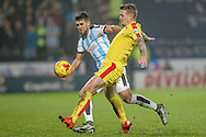 Tommy Smith (Huddersfield Town) and Danny Ward (Rotherham United) during the Sky Bet Championship match between Huddersfield Town and Rotherham United at the John Smiths Stadium, Huddersfield, England on 15 December 2015. Photo by Mark P Doherty.