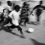 Children play football  in IFO camp in Dadaab, world's largest refugee camp in Eastern Kenya. Photo: Sanjit Das/Panos