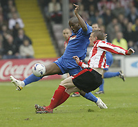 Photo: Aidan Ellis.<br /> Lincoln City v Grimsby Town. Coca Cola League 2, Play off Semi Final. 13/05/2006.<br /> Grimsby's Junior Mendes closes down Lincoln's Jeff Hughes