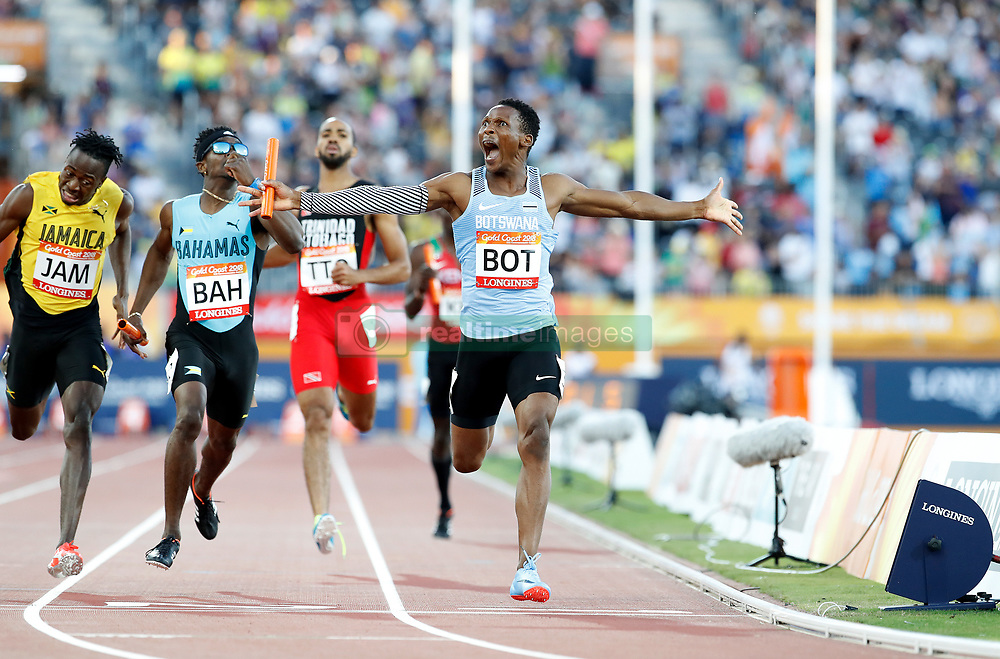 Botswana's Isaac Makwala celebrates winning gold in the Men's 4 x 400m Relay Final at the Carrara Stadium during day ten of the 2018 Commonwealth Games in the Gold Coast, Australia. PRESS ASSOCIATION Photo. Picture date: Saturday April 14, 2018. See PA story COMMONWEALTH Athletics. Photo credit should read: Martin Rickett/PA Wire. RESTRICTIONS: Editorial use only. No commercial use. No video emulation.
