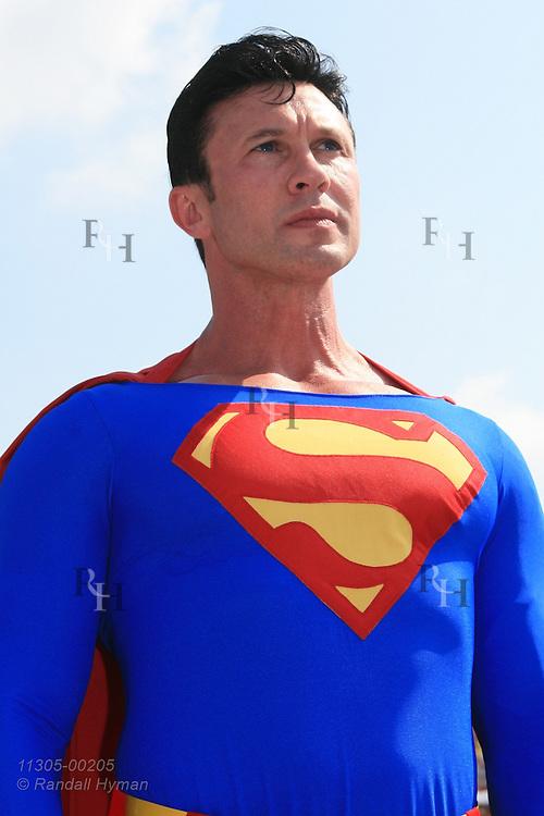 Superman devotee, Danny Kelley, dresses the part and poses at Superman Celebration; Metropolis, Illinois.