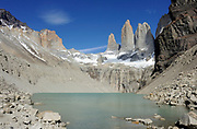 The granite spires of the Torres del Paine from the west  looking across the Torres Glacier and its glacial lake from the Mirador Las Torres. Torre Sur is on the left then Torre Central then Torre Nord. The slopes of Monte Almirante Nieto are on the far left and those of Cerro Nido de Condor on the far right. Torres del Paine National Park, Republic of Chile 18Feb13