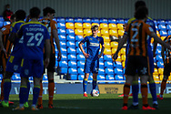 AFC Wimbledon midfielder Jack Rudoni (12) about to take a free kick during the EFL Sky Bet League 1 match between AFC Wimbledon and Hull City at Plough Lane, London, United Kingdom on 27 February 2021.