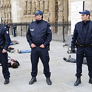 Protesters and counter-protesters clash in Paris directly in front of Notre Dame Cathedral over the Pope's recent comments that condoms were not a solution to the problem of AIDS in Africa. Police made 11 arrests