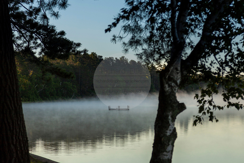 A swim platform on a foggy sunrise morning on Trout Lake in the Northwoods village of Boulder Junction, Wisconsin.