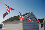 Union Jack flags flutter on a summer breeze at the Suffolk seaside town of Southwold, Suffolk.