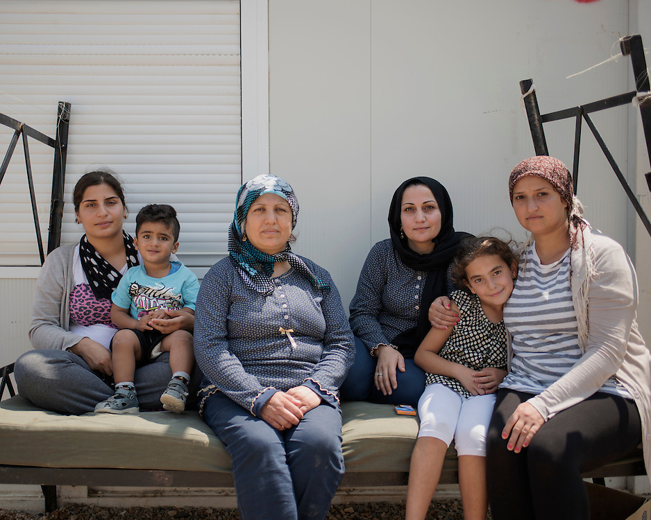 Shirin, Levent, Jamila, Wafa, Aya, Rania (L-R) refugees from Aleppo and Al Hasakah outside their hut in the First Reception Centre (Hot-Spot) of Leros, Greece. <br /> <br /> The Hot Spot in Lepida opened on the 26th of February 2016 in the grounds of the former Lepida psychiatric hospital.  At the beginning it served as a registration camp for refugees and migrants who were travelling to Europe through Greece but since the closure of the borders in March 2016 it serves as a permanent camp. People are allowed to go out, they have three meals a day, the prefabricated huts have a bathroom and are air-conditioned and compering to other refugee camps in Greece the conditions are bearable.