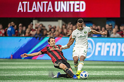 December 8, 2018 - Atlanta, Georgia, United States - Atlanta United defender MICHAEL PARKHURST (3) fights for the ball against Portland Timbers forward JEREMY EBOBISSE (17) during the MLS Cup at Mercedes-Benz Stadium in Atlanta, Georgia.  Atlanta United defeats Portland Timbers 2-0 (Credit Image: © Mark Smith/ZUMA Wire)